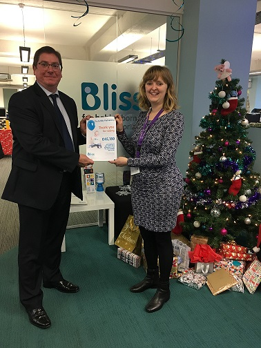 Andrew Came, the CEO of the Fertility Partnership, presents a donation of £45,150 to Bliss Baby Charity